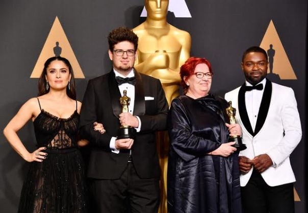 HOLLYWOOD, CA - FEBRUARY 26: (L-R) Actor Salma Hayek, director Kristof Deak and producer Anna Udvardy, winners of Best Live Action Short Film for 'Sing' and actor David Oyelowo pose in the press room during the 89th Annual Academy Awards at Hollywood & Highland Center on February 26, 2017 in Hollywood, California.  (Photo by Frazer Harrison/Getty Images)